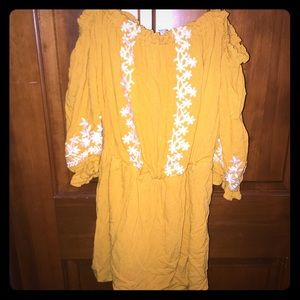 Fun for summer: Yellow Romper with flower details